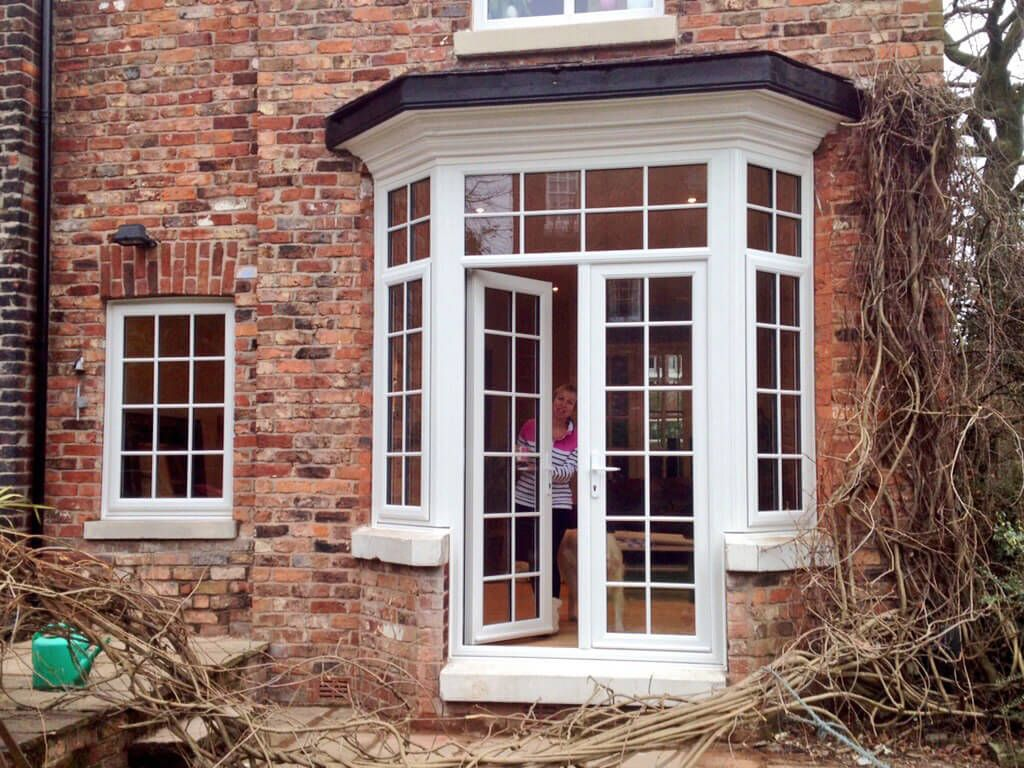 Turn a bay window into french doors google search for Porch windows and doors