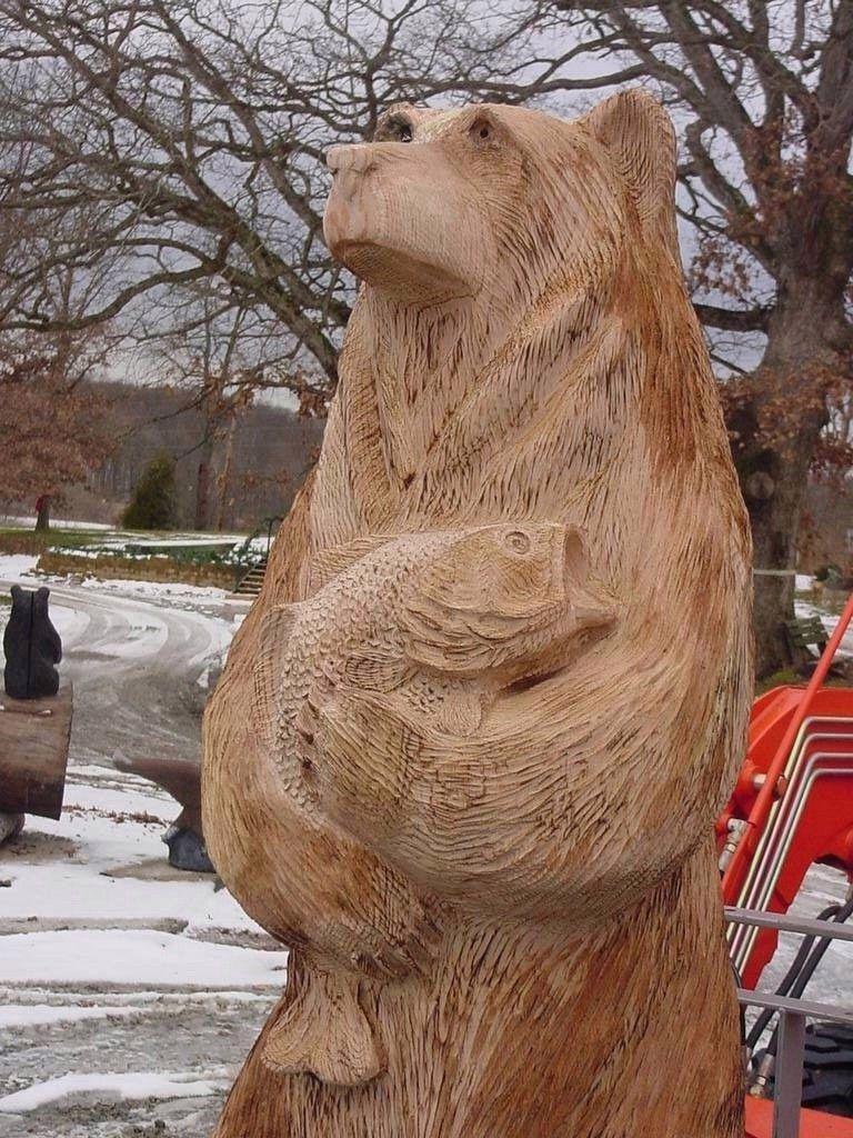 Bear holding largemouth bass ft tall chainsaw