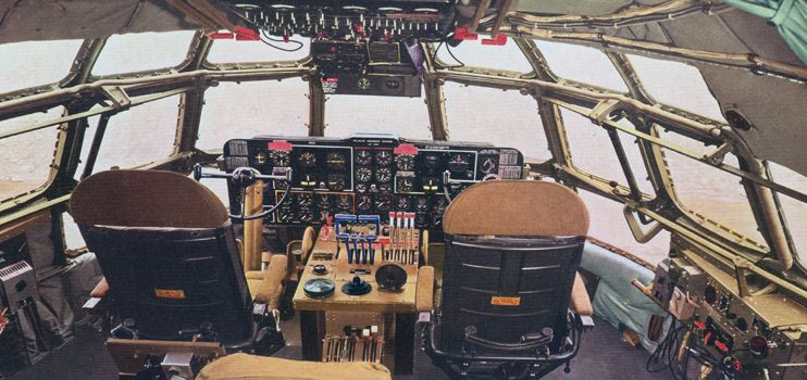 BOEING 377 STRATOCRUISER AIRLINER PILOTS IN COCKPIT OF AIRPLANE PHOTO AVIATION