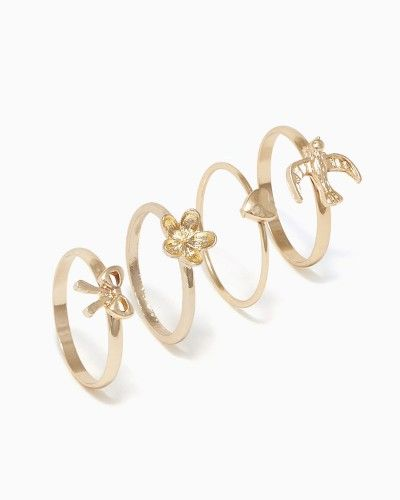 Shop for girly jewelry like this set of four stackable rings: a tiny heart, delicate flower, itty bitty bow and soaring bird.