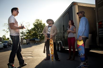 Project SLC founder and his wife Chelsea present the longboards to the members of #ESMZ