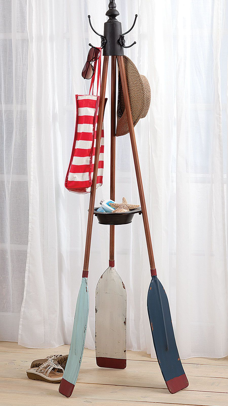 Repurpose old oars and a coat rack