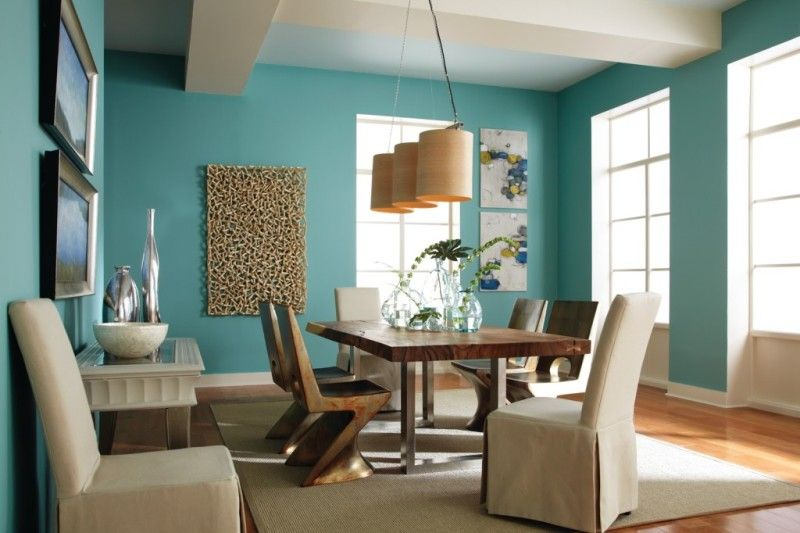 dining room with light teal walls dining room
