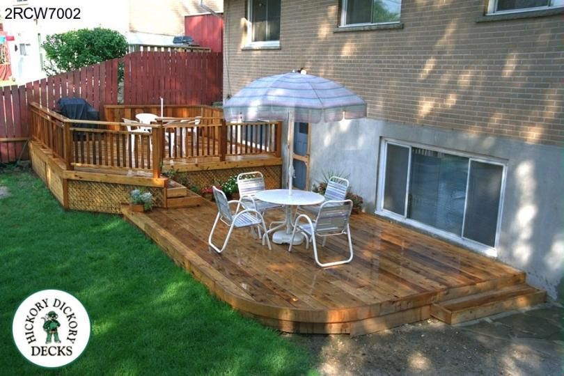 Large low two level deck with a curved face outside for Multi level deck plans