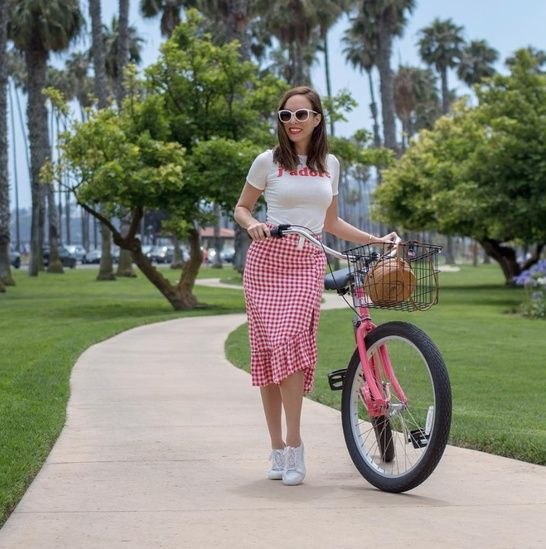 310d5d29b654 Dressed up for a bike ride in a graphic tee and gingham skirt #ShopStyle  #shopthelook #SummerStyle #BeachVacation #WeekendLook