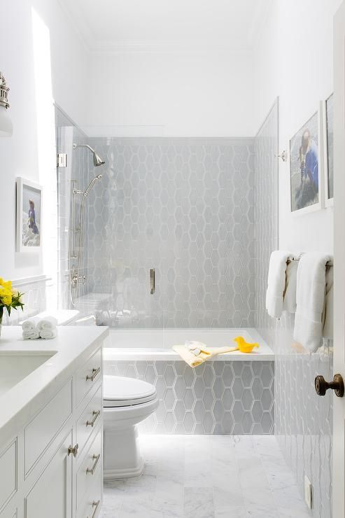 Marble Floor Tiles Lead Past A White Washstand To A Gray Glass - Honeycomb tile bathroom