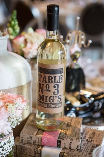 We can get wine bottles with labels for the tables my friends own a winery and we can give them as gifts as well!