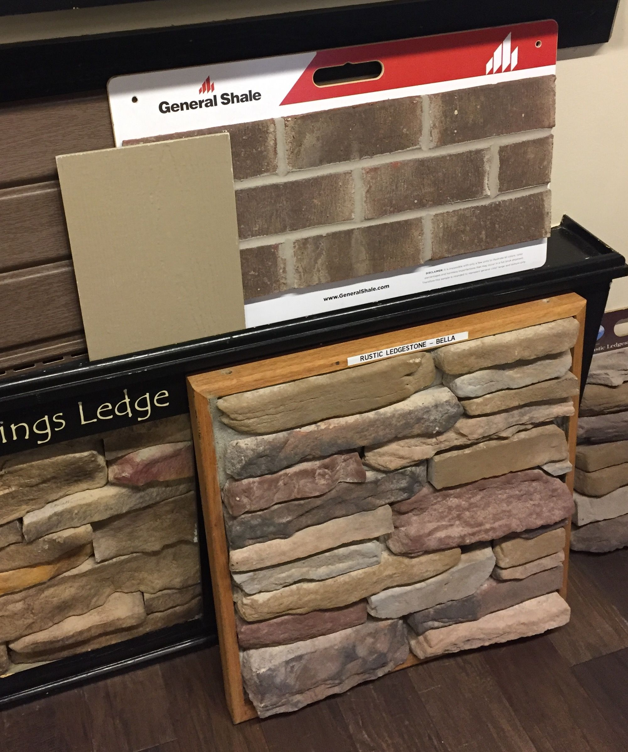 Exterior Millstone Brick Gray Mortar Bella Stone Weathered Wood Roof  Stucco Khaki Brown Trim Boards