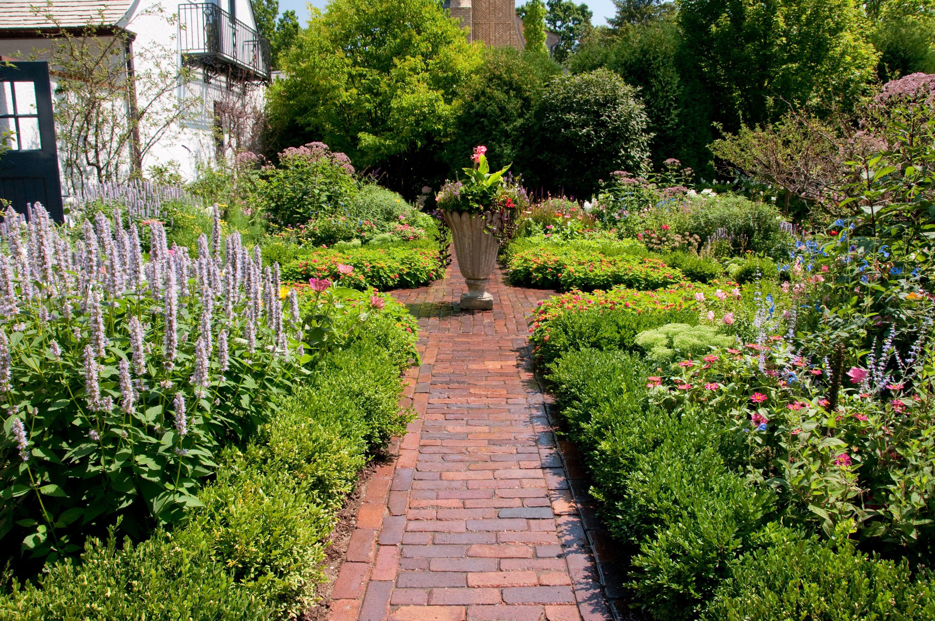 Perennial Garden Paver Walks By Premier Service Perennial Garden Garden Pavers Landscape Design