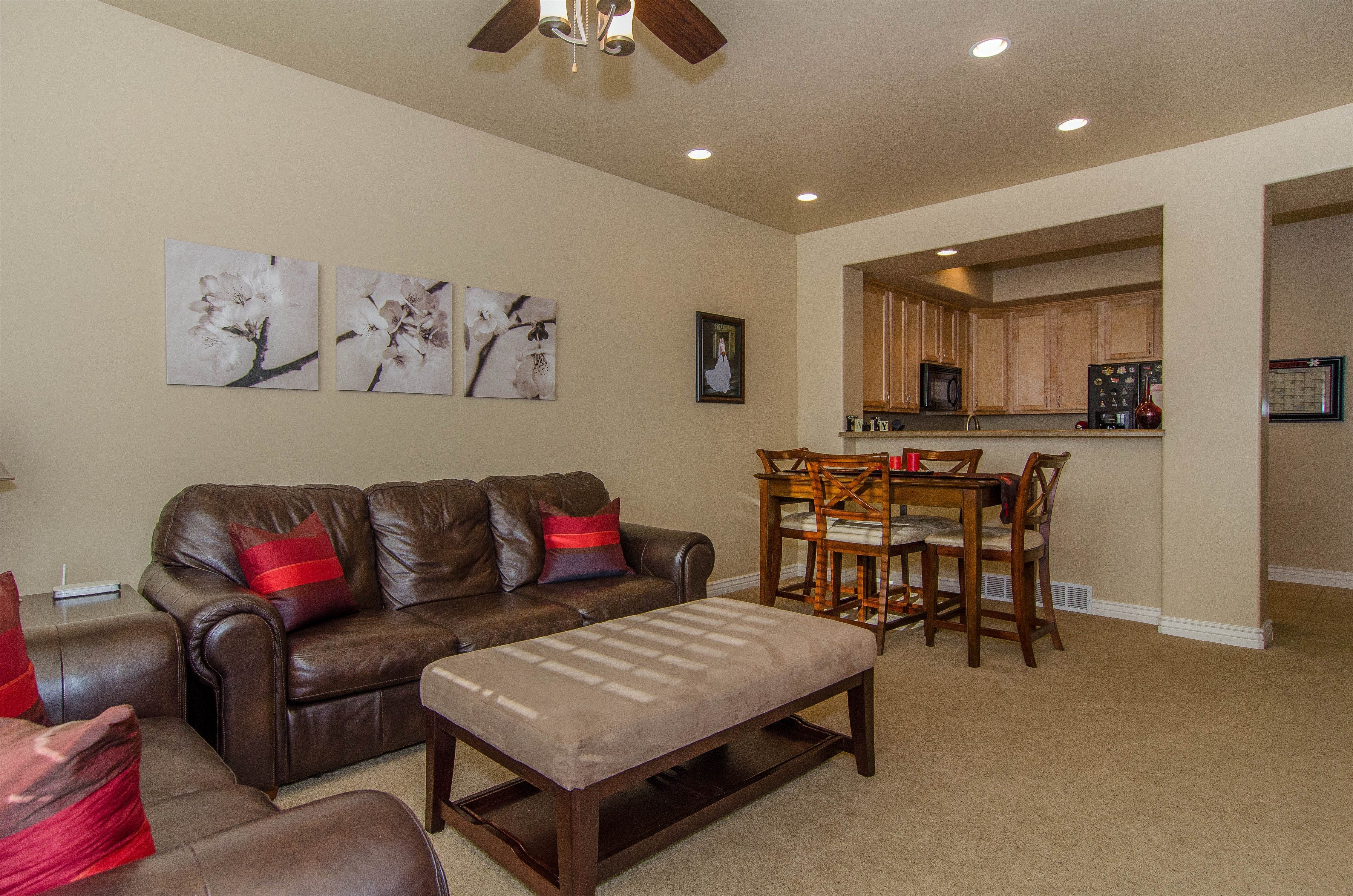 Living room, looking into kitchen - 10773 S Ozarks Dr, South ...