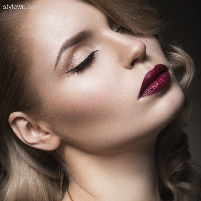 A glamorous shimmery black smokey eye and red lips makeup
