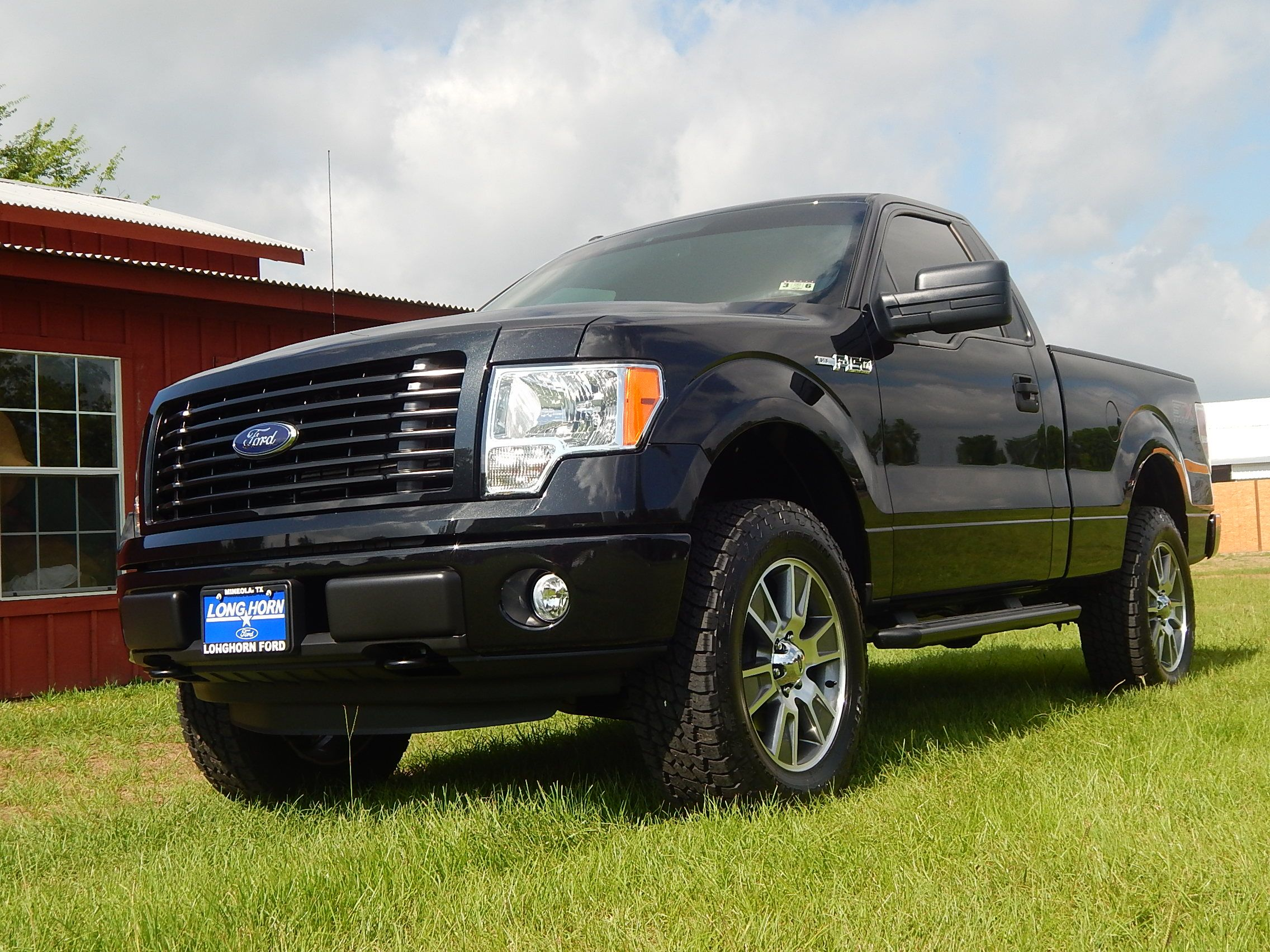 2014 ford f 150 stx regular cab 4x4 with a custom leveling kit 20