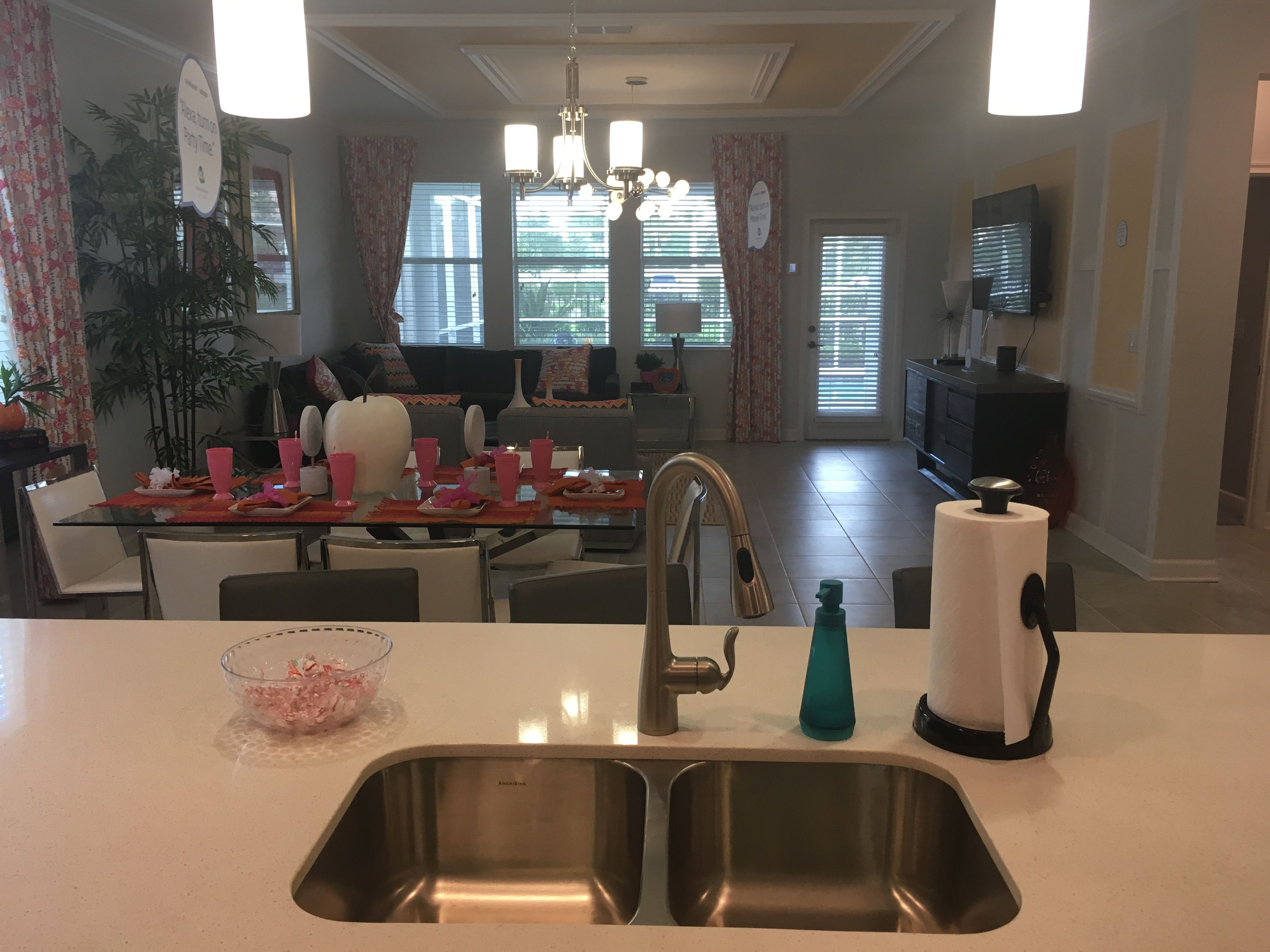 Does your current sink face a wall or overlooks the dining and living room  like this