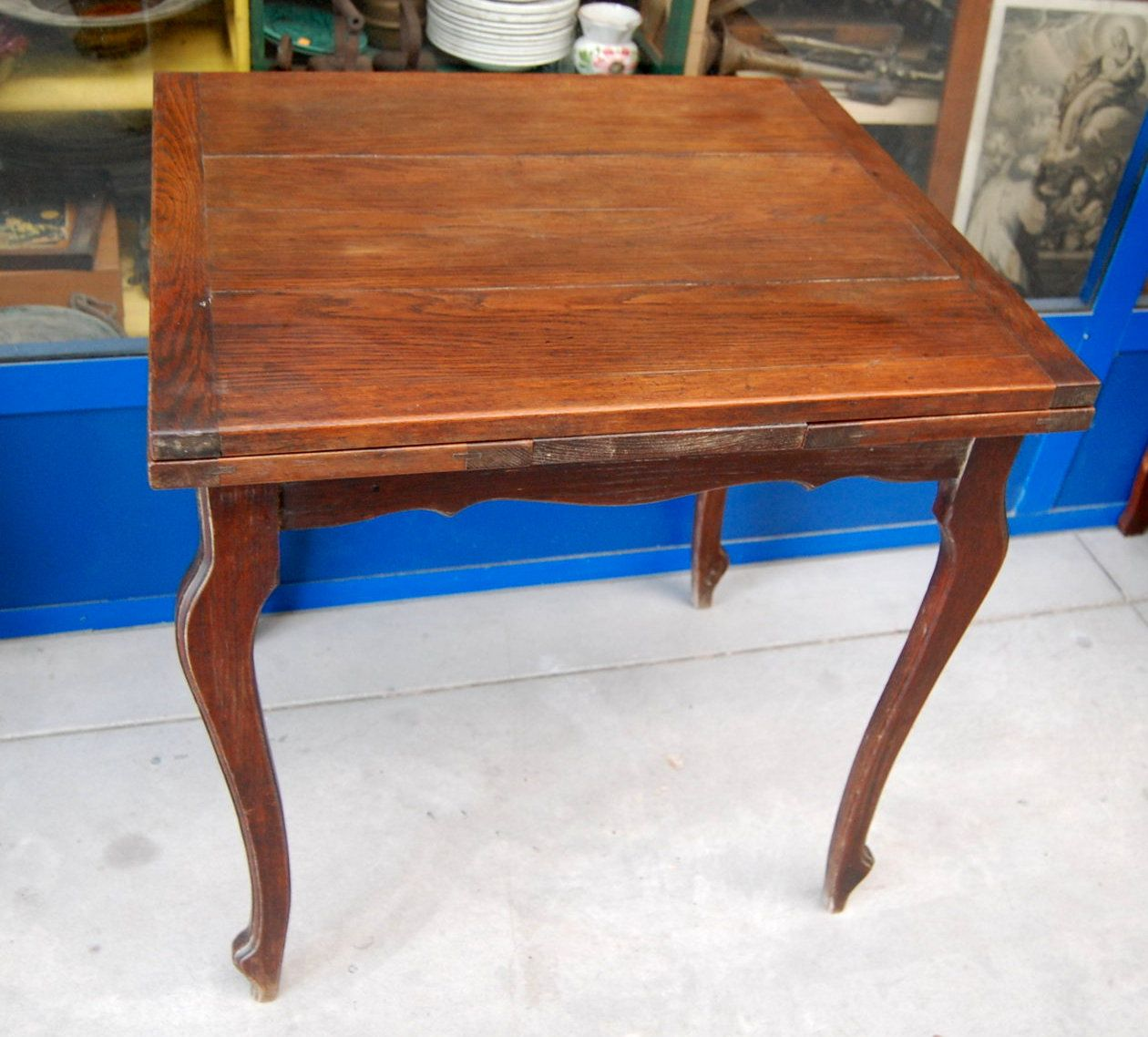 Piccolo tavolo allungabile 'a tiro' 70 x 60 più 2 allunghe