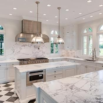 White Kitchen With Black And Harlequin Tile Floor