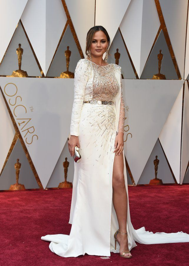 9feef732643 Chrissy Teigen looks stunning in a white Zuhair Murad Couture gown ...