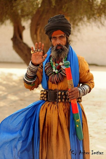 man from Kasur, Pakistan - Asher Imtiaz. The style, the color, the adornment...lovely!
