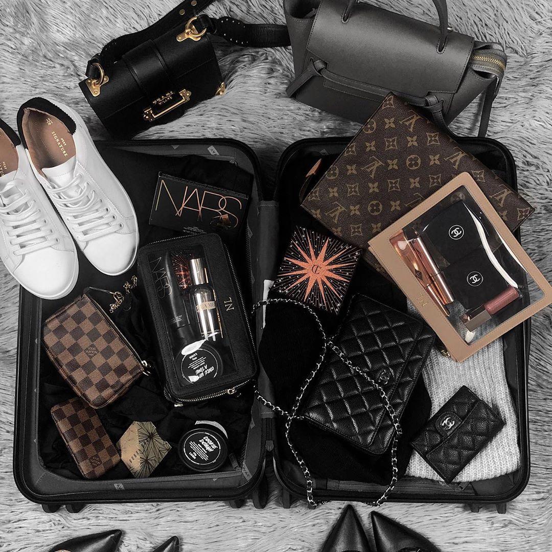 Suitcase flatlay beauty makeup flatlay / Instagram