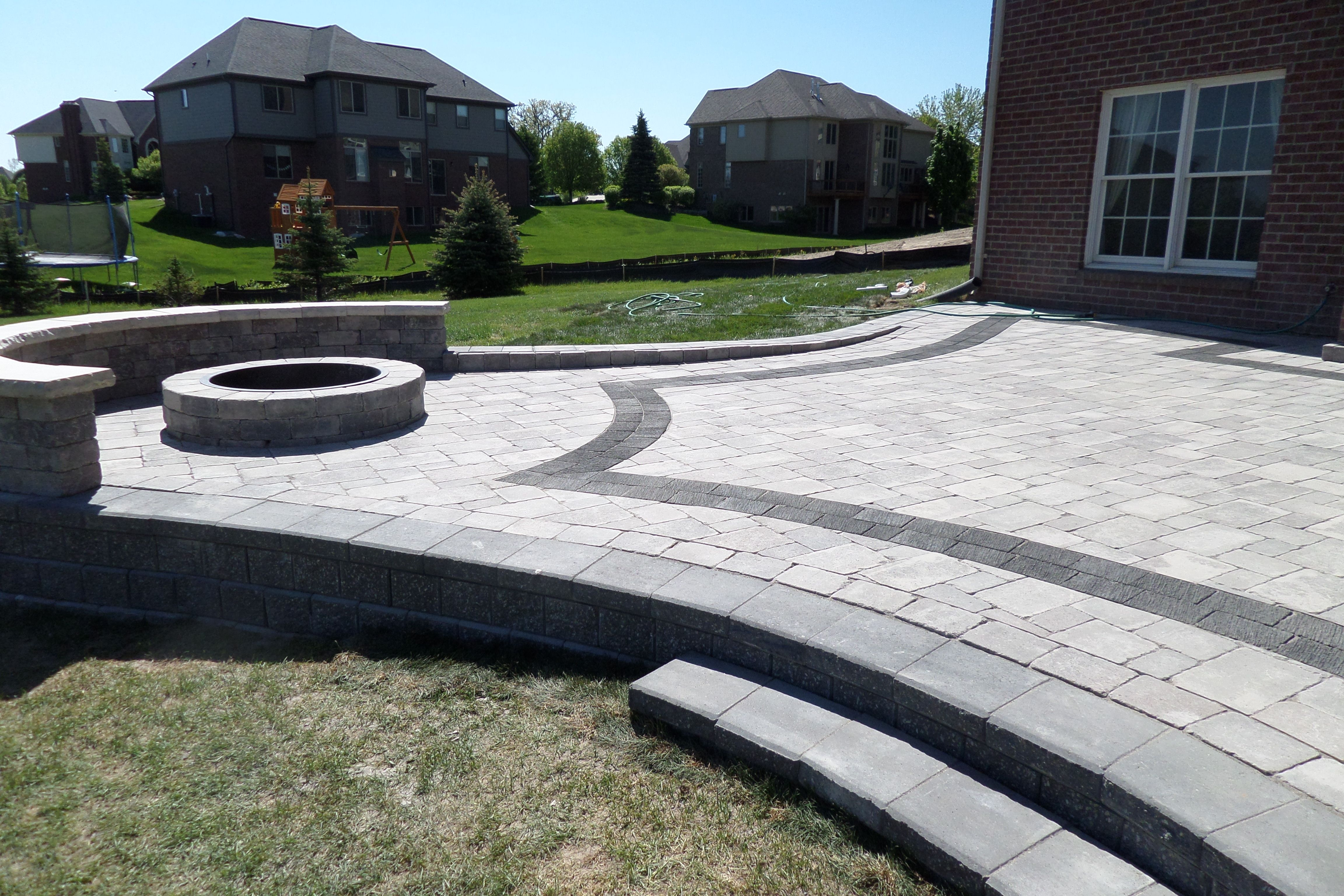 Raised Unilock Pisa Ii Patio With A Fire Pit And Seat Wall Pavers Are