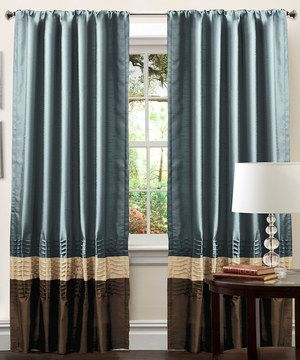 Add an element of elegance to the décor and adorn a window with this classic curtain set. With a series of luxurious pleats alongside an attractive palette of complementary colors, these stylish treatments feature conveniently built-in pockets that easily slide onto a rod for quick installation.