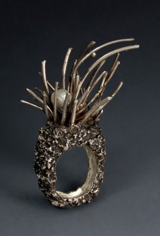 """Anemone"" by Robert Thomas mullen. 2007.  Sterling silver, freshwater pearl."