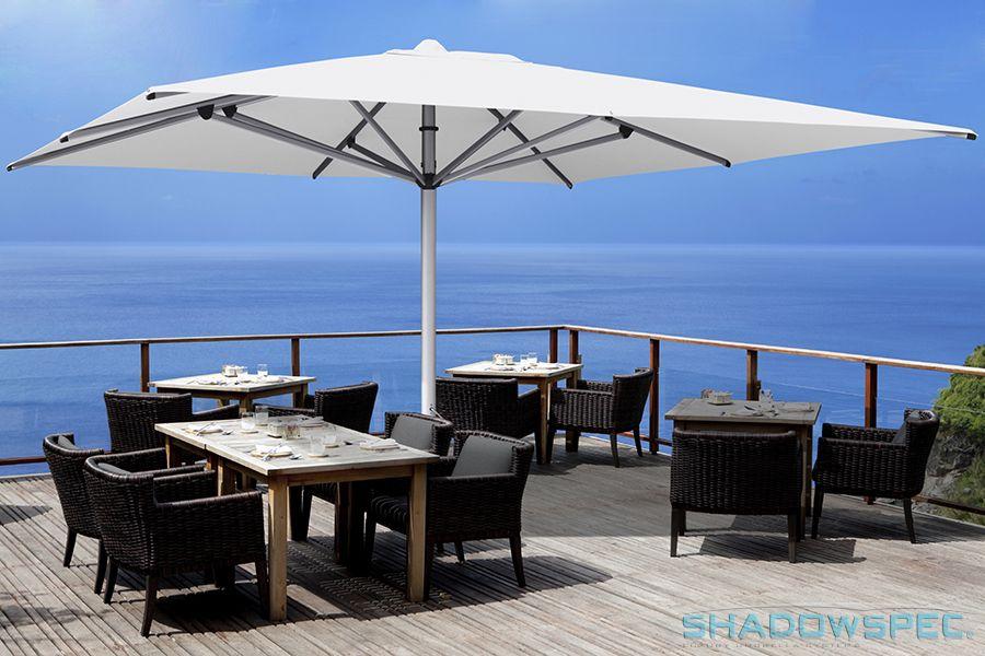 Shadowspec Global Suppliers Of Luxury Outdoor Umbrella Systems No Room In Your Budget For A Awning Or Pergola A Shado Shade Umbrellas Pergola Pergola Patio
