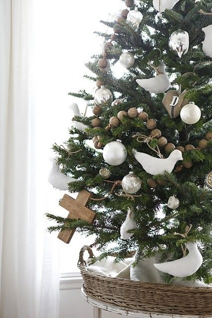 contemporary christmas tree with white and wooden decorations