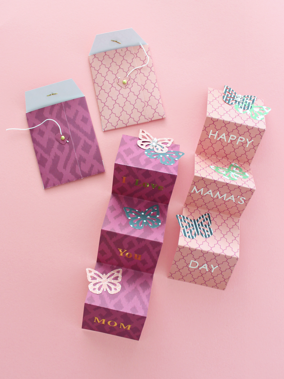 Give mom something different this year: an accordion card that you can make with a matching button envelope!I used this Heidi Swapp paper pad to create th