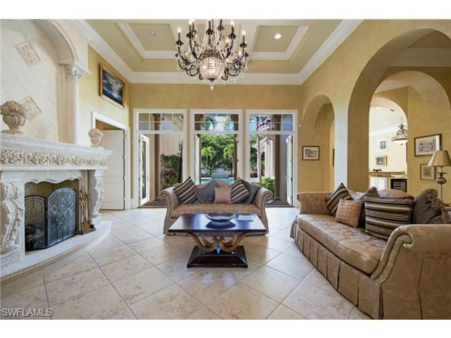 28350 Terrazza Naples Florida 34110 Elegant Golf Villa Formal Living Room With Fireplac Formal Living Rooms Living Room With Fireplace Naples Real Estate