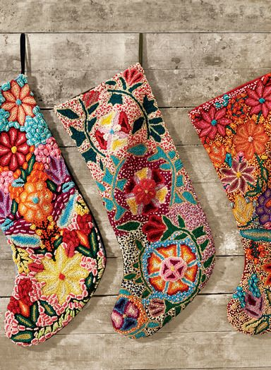 These masterfully hand-embroidered wool stockings will add a colorful, folkloric touch to your mantel. Solid cotton back. From left to right: Blue, Pine or Berry.