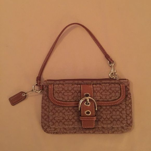 Lowered Price NWOT Coach Wristlet NWOT Coach Beige and Brown signature Wristlet. New without any  flaws or markings. Authentic. Comes with Coach Box. Please ask me any questions and God Bless You Coach Bags Clutches & Wristlets