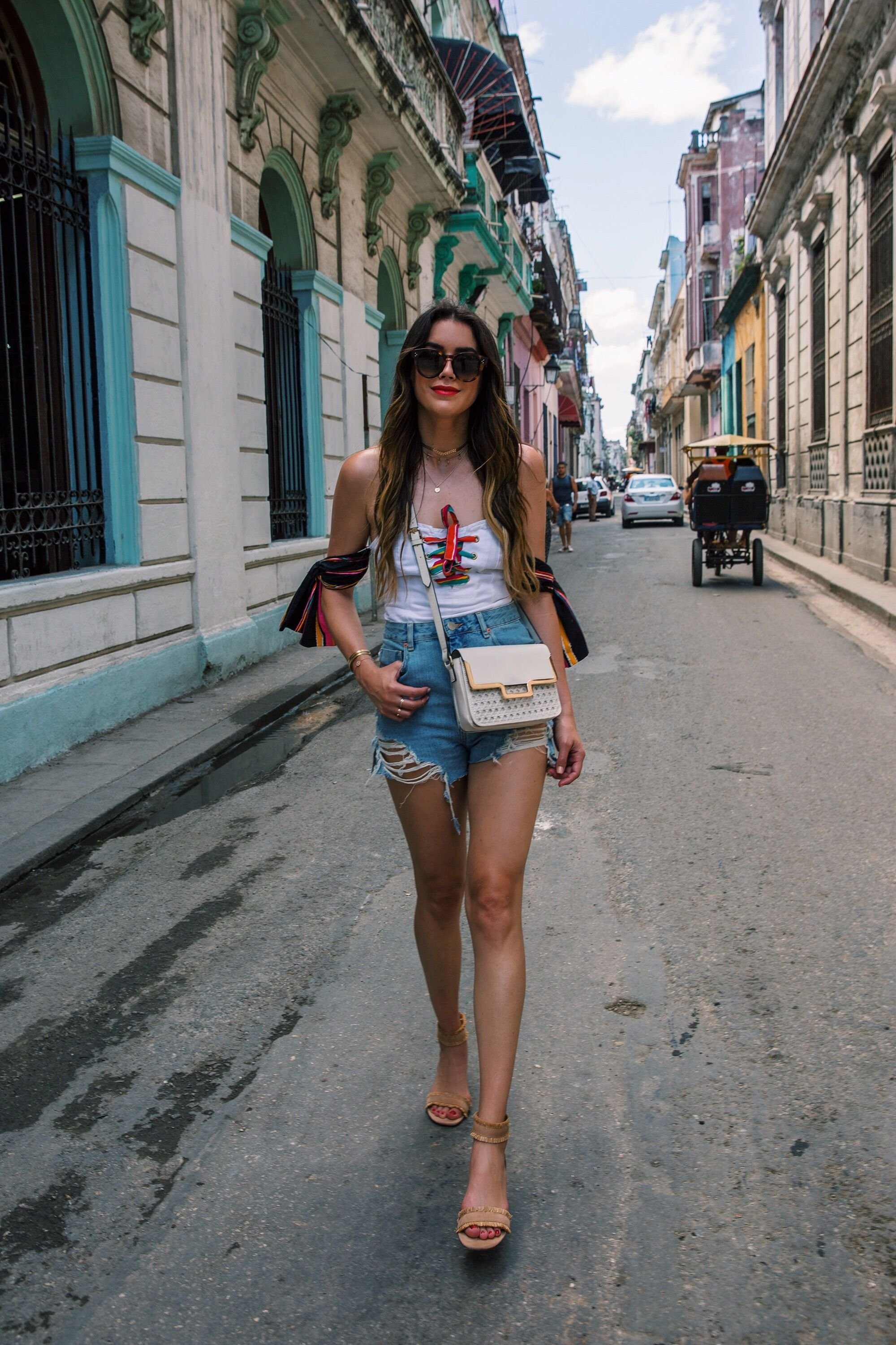f3b42278 Top+distressed denim shorts+ankle strap sandals+natural coloured crossbody  bag+choker+necklaces+sunglasses. Summer Vacation Outfit 2017