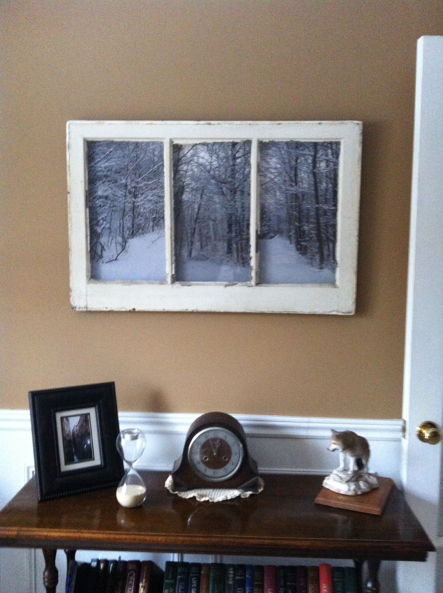 Take an old window frame and add photos behind the glass.   My DIY ...
