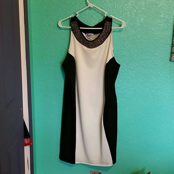 Beaded bodycon dress Very comfortable black and white bodycon dress.  Beads are somewhere between gold and silver. 4% spandex. Urban Rose Dresses