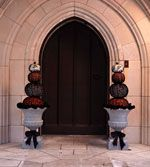 Lace pumpkins, and lightweight urns sprayed with gray stone paint. Elegant look for Halloween....