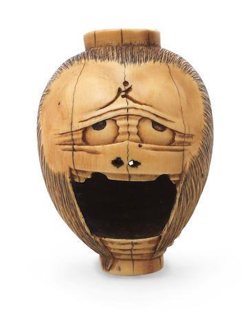 An ivory netsuke of the lantern ghost Oiwa Late 19th century