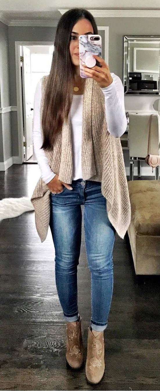 8030dc6ba3 winter outfit   white top + knit vest + skinny jeans + boots