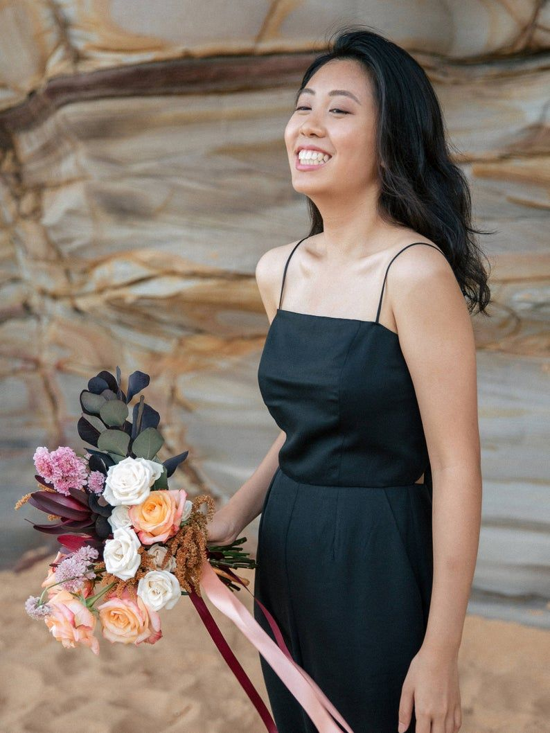 Bridesmaid jumpsuit with back bow tie and wide leg trousers. This elegant black jumpsuit is perfect for bridesmaids and bohemian weddings #bridesmaidjumpsuits