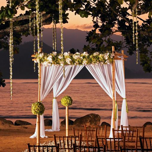 Pinned for flowers hanging..l consider look with ribbons? consider look from tree limbs around the group. 16 Hawaii Wedding Venues for Any Budget