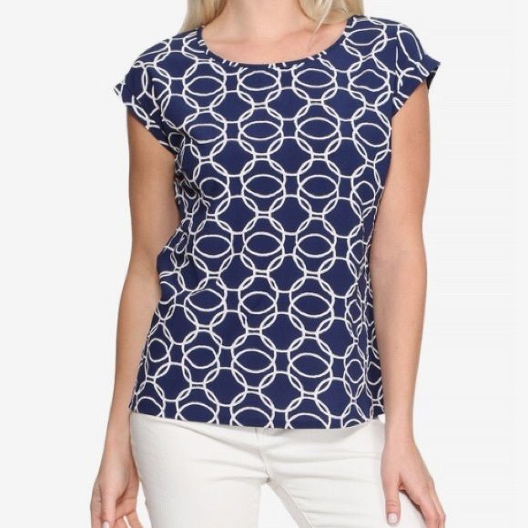 HP!Flora Printed Top Royal blue blouse with white ring pattern. Dressy casual perfect for the office, or dress down with jeans. Half zip rear closure. Great condition. Noir Tops Blouses