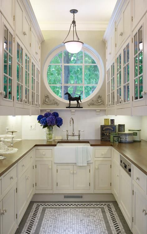 Journal of Interior Design good use of glass panel cupboards in