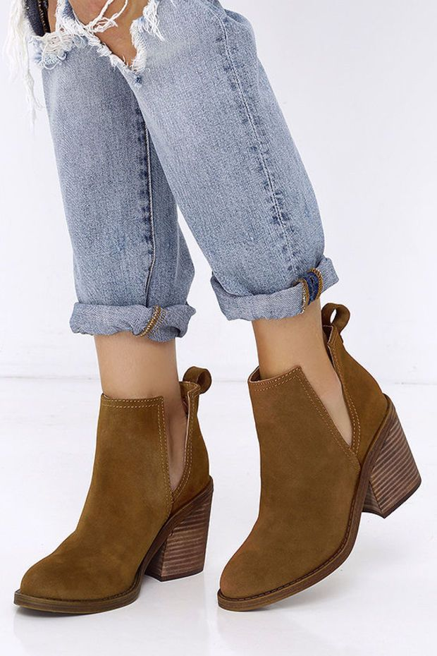 Fans of cutting-edge footwear will love the Steve Madden Sharini Chestnut  Suede Leather Ankle Booties! These easy-wearing genuine suede boots feature  side ...
