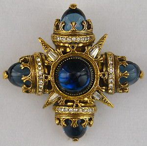 This is the first time I've seen the cabochon version in blue with the dark gold finish.  The stones BENEDIKT OF NEW YORK SAPPHIRE BLUE CABOCHON & RHINESTONE VINTAGE BROOCH.