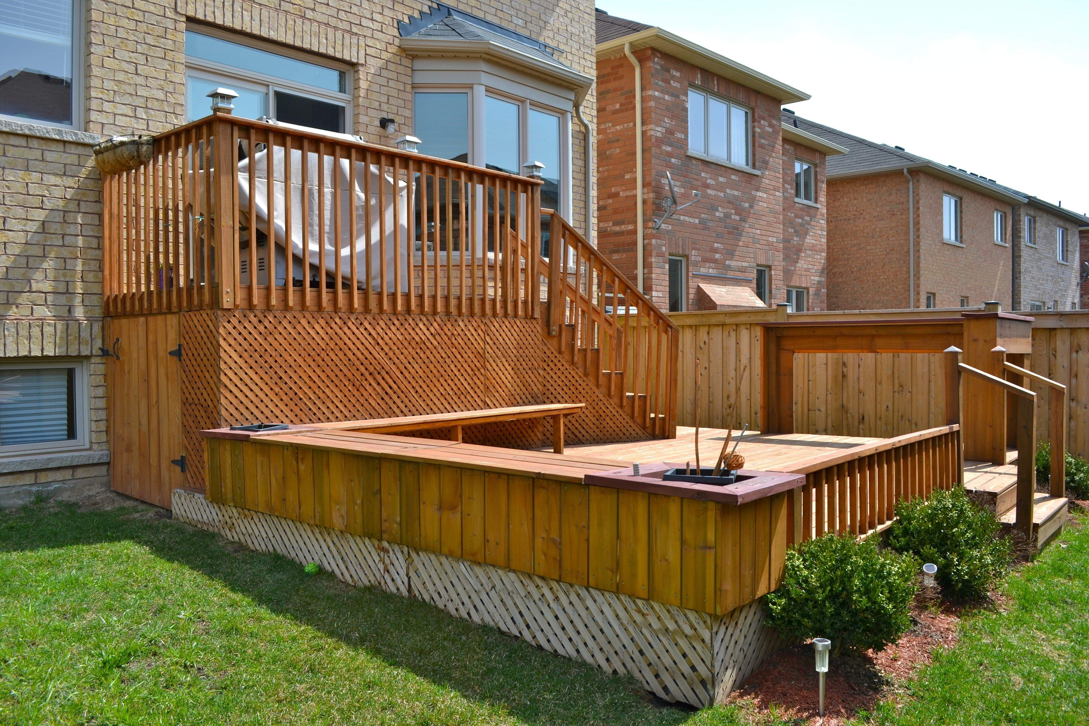 pin multi level backyard deck with planters and benches boxboro ma
