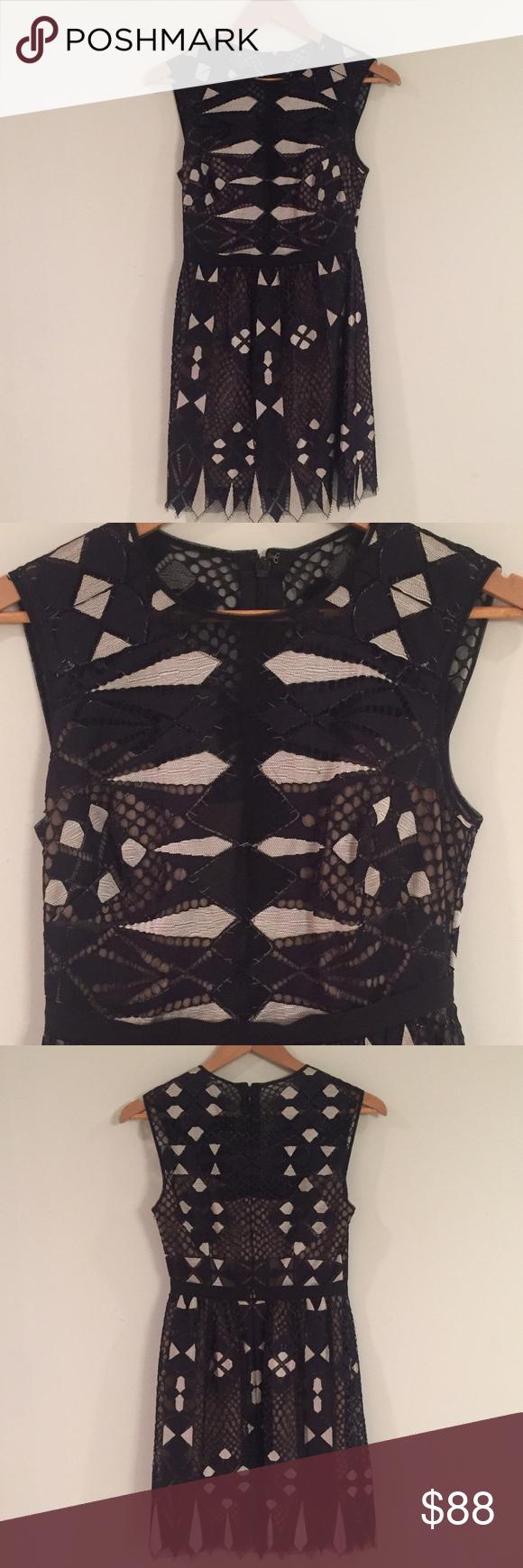 BCBG Dress BCBG Dress black and cream sheer detail with beige lining. Deep sheer V on bodice. BCBGMaxAzria Dresses Midi