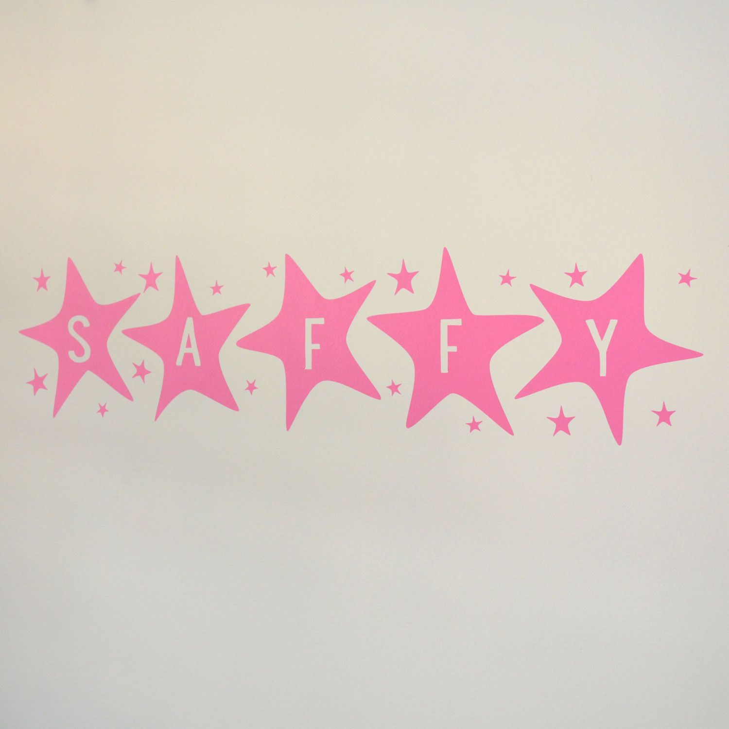 Large Name in the Stars Wall Stickers. Having their name cut out of big colourful stars that look as though they've been painted on to the wall will be sure brighten your child's room!  The letter colour shown in the image is Rose Pink, although this product is available in our full range of colours.  Dimensions: Big stars are approx 22cm high x approximately 20cm per star