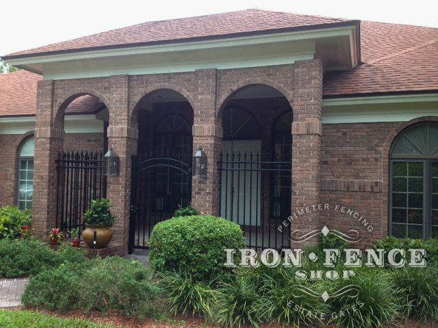 Brick Entryway To A House Accentuated By Our 6ft Tall Classic Style Wrought  Iron Fence And