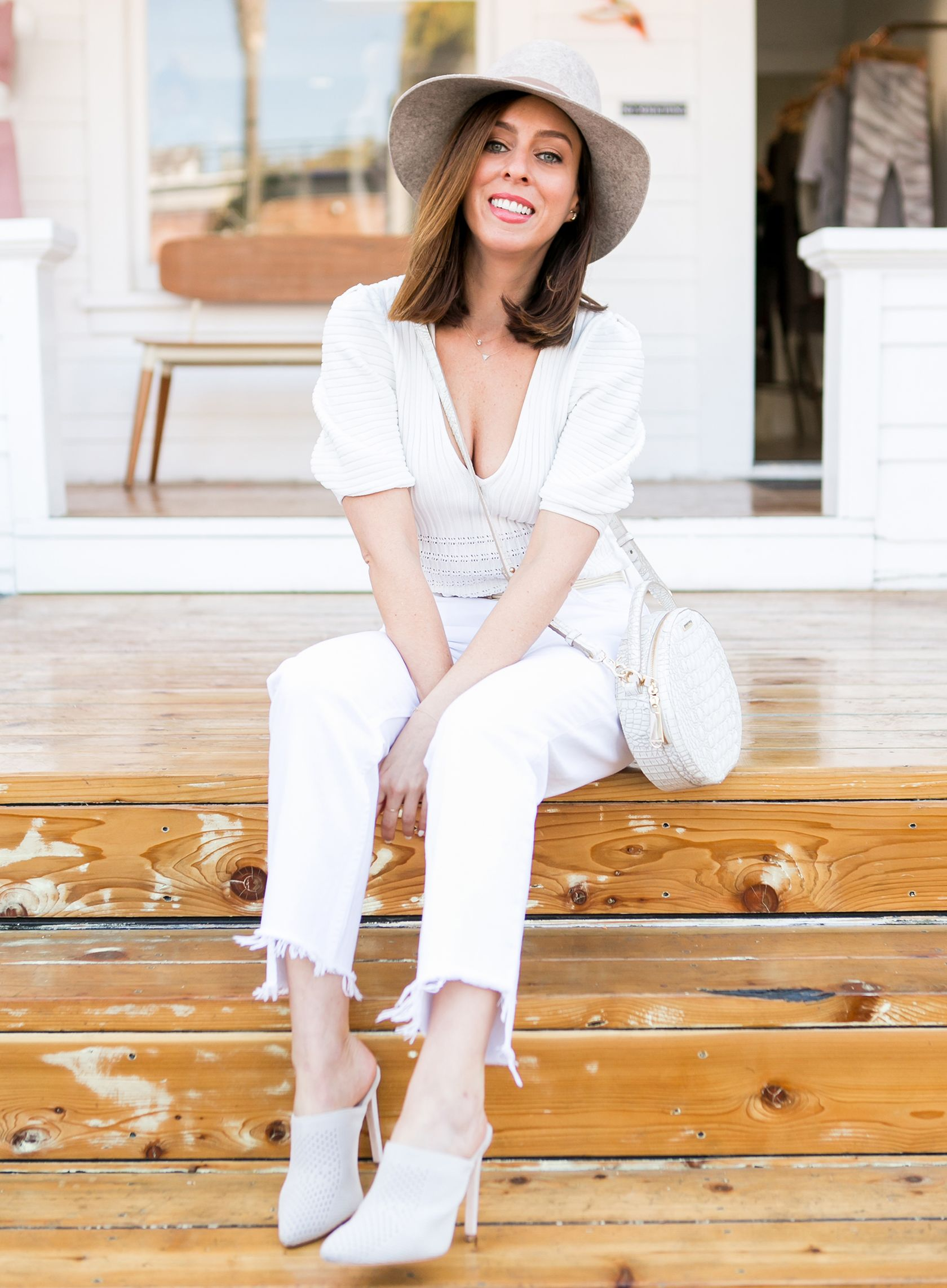 0be37d3195df Sydne Style shows casual spring outfit ideas in white jeans and mules