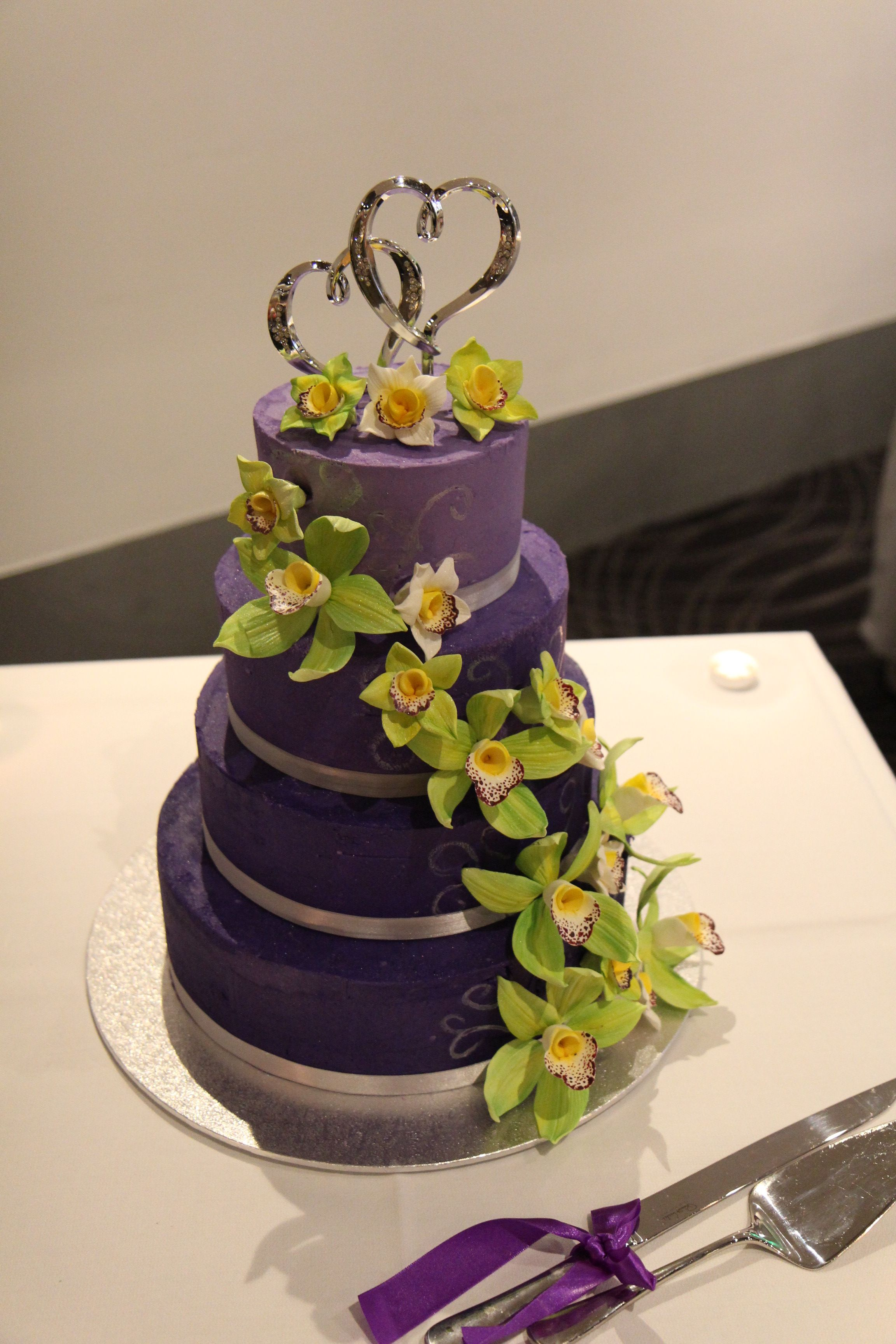 4 Tier Purple Wedding Cake With Lime Green Orchids And A Silver