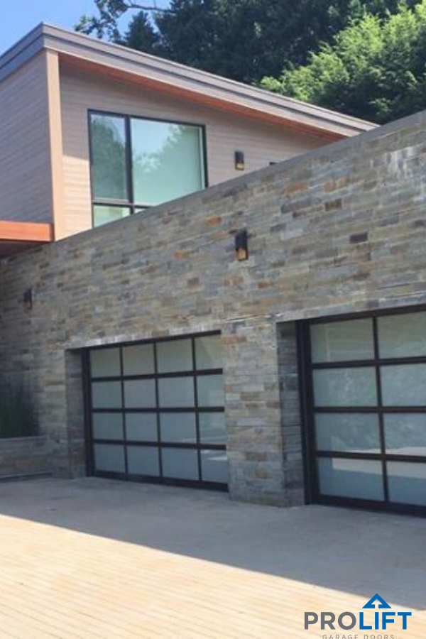 Full Vision Glass Garage Door Panels With Black Aluminum Frames In 2020 Glass Garage Door Garage Doors Modern Garage Doors